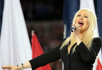 ARLINGTON, TX - FEBRUARY 06:  Singer Christina Aguilera sings the National Anthem during Super Bowl XLV between the Pittsburgh Steelers and the Green Bay Packers at Cowboys Stadium on February 6, 2011 in Arlington, Texas.  (Photo by Jamie Squire/Getty Ima