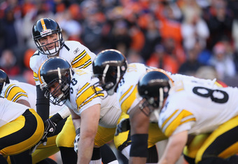 DENVER, CO - JANUARY 08:  Quarterback Ben Roethlisberger #7 of the Pittsburgh Steelers prepares to take a snap against the Denver Broncos during the Wild Card Playoffs at Sports Authority Field at Mile High on January 8, 2012 in Denver, Colorado.  (Photo