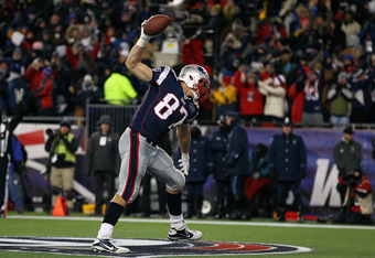 FOXBORO, MA - JANUARY 14:  Rob Gronkowski #87 of the New England Patriots celebrates by spiking the ball after he scored a 19-yard touchdown reception in the second quarter against the Denver Broncos during their AFC Divisional Playoff Game at Gillette St