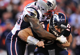 DENVER, CO - DECEMBER 18: Defensive end Mark Anderson #95 of the New England Patriots sacks quarterback Tim Tebow #15 of the Denver Broncos in the third quarter at Sports Authority Field at Mile High on December 18, 2011 in Denver, Colorado. The New Engla