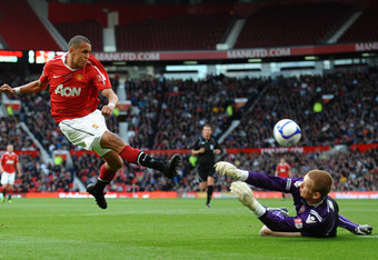 MANCHESTER, ENGLAND - MAY 23: Ravel Morrison of Manchester United has his shot saved by George Long of Sheffield United during the FA Youth Cup Final 2nd Leg match between Manchester United and Sheffield United at Old Trafford on May 23, 2011 in Mancheste