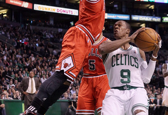BOSTON, MA - JANUARY 13:  Rajon Rondo #9 of the Boston Celtics heads to the basket as Derrick Rose #1 of the Chicago Bulls defends on January 13, 2012 at TD Garden in Boston, Massachusetts. NOTE TO USER: User expressly acknowledges and agrees that, by dow