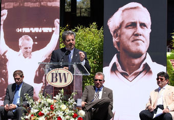 SAN FRANCISCO - AUGUST 10:  Former San Francisco 49ers executive Carmen Policy speaks during a public memorial service for former 49ers coach Bill Walsh as Steve Young (L), Joe Montana (C) and Eddie DeBartolo look on August 10, 2007 at Monster Park in San