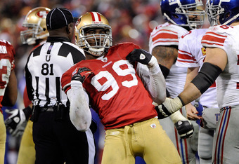 SAN FRANCISCO, CA - JANUARY 22:  Aldon Smith #99 of the San Francisco 49ers reacts against the New York Giants in the second half during the NFC Championship Game at Candlestick Park on January 22, 2012 in San Francisco, California.  (Photo by Thearon W.