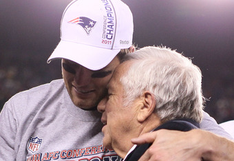 FOXBORO, MA - JANUARY 22:  Tom Brady #12 of the New England Patriots hugs Robert Kraft, team owner of the New England Patriots after defeating the Baltimore Ravens in the AFC Championship Game at Gillette Stadium on January 22, 2012 in Foxboro, Massachuse