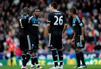BLACKBURN, ENGLAND - NOVEMBER 05:  John Terry of Chelsea speaks to team mates Ramires (L), Daniel Sturridge and Florent Malouda (R) during the Barclays Premier League match between Blackburn Rovers and Chelsea at Ewood Park on November 5, 2011 in Blackbur