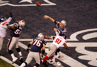 Justin Tuck forces Tom Brady into intentional grounding.