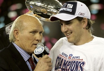 GLENDALE, AZ - FEBRUARY 03:  Quarterback Eli Manning #10 of the New York Giants is interviewed by FOX broadcaster Terry Bradshaw after defeating the New England Patriots 17 0 14 after Super Bowl XLII on February 3, 2008 at the University of Phoenix Stadiu