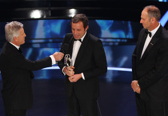 LONDON, ENGLAND - FEBRUARY 06:  TV presenter Steve Rider (L) speaks with Sandro Rosell, (C)  Barcelona Chairman on stage after accepting the Laureus World Team of the Year Award on behalf of the team while Academy member Sir Steve Redgrave (R) looks on at