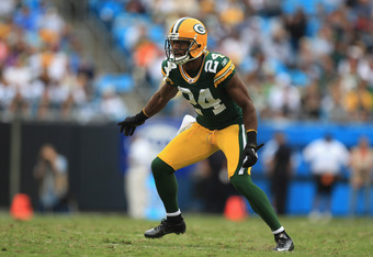 CHARLOTTE, NC - SEPTEMBER 18:   Jarrett Bush #24 of the Green Bay Packers during their game against the Carolina Panthers at Bank of America Stadium on September 18, 2011 in Charlotte, North Carolina.  (Photo by Streeter Lecka/Getty Images)