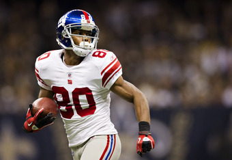 NEW ORLEANS, LA - NOVEMBER 28:   Victor Cruz #80 of the New York Giants runs a pass in for a touchdown against the New Orleans Saints at Mercedes-Benz Superdome on November 28, 2011 in New Orleans, Louisiana.  The Saints defeated the Giants 49 to 24.  (Ph