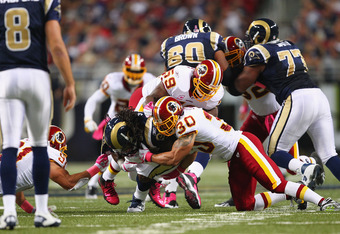 ST. LOUIS, MO - OCTOBER 02: LaRon Landry #30 of the Washington Redskins makes a tackle against the St. Louis Rams at the Edward Jones Dome on October 2, 2011 in St. Louis, Missouri.  The Washington Redskins beat the St. Louis Rams 17-10.  (Photo by Dilip