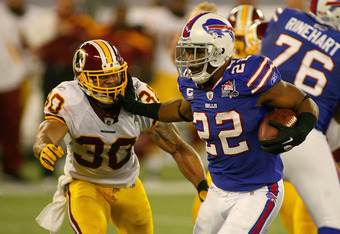 TORONTO, ON - OCTOBER 30:  Fred Jackson #22 of the Buffalo Bills runs by LaRon Landry #30 of the Washington Redskins at Rogers Centre on October 30, 2011 in Toronto, Ontario.  (Photo by Rick Stewart/Getty Images)