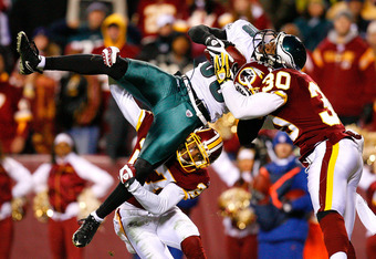 LANDOVER, MD - DECEMBER 21:  Receiver Reggie Brown #86 of the Philadelphia Eagles is stopped just short of the end zone by Fred Smoot #27 and LaRon Landry #30 of the Washington Redskins during the game on December 21, 2008 at FedEx Field in Landover, Mary