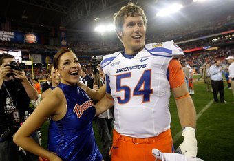 GLENDALE, AZ - JANUARY 04:  Michael Ames #54 of the Boise State Broncos puts his arm around a cheerleader after the Broncos 17-10 victory against the TCU Horned Frogs during the Tostitos Fiesta Bowl at the Universtity of Phoenix Stadium on January 4, 2010