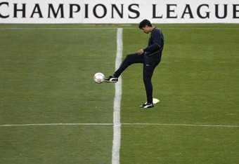 BARCELONA, SPAIN - APRIL 08:  Coach Frank Rijkaard of Barcelona kicks the ball during a Barcelona training prior to tomorrows Champions League Quarter Final match against Schalke on April 8, 2008 in Barcelona, Spain.  (Photo by Jasper Juinen/Getty Images)