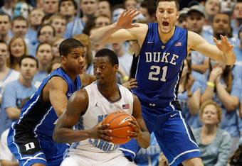 CHAPEL HILL, NC - FEBRUARY 08:  Miles Plumlee #21 of the Duke Blue Devils and teammate Andre Dawkins #20 trap Harrison Barnes #40 of the North Carolina Tar Heels during their game at the Dean Smith Center on February 8, 2012 in Chapel Hill, North Carolina