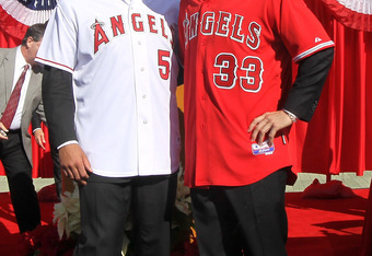 Yes, C.J. Wilson is taller than Albert Pujols. Pujols is older, though.  By about 15 years, most likely.