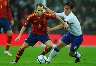 LONDON, ENGLAND - NOVEMBER 12:  Andres Iniesta of Spain battles with Scott Parker of England during the international friendly match between England and Spain at Wembley Stadium on November 12, 2011 in London, England.  (Photo by Laurence Griffiths/Getty
