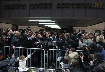 LONDON, ENGLAND - FEBRUARY 08:  Harry Redknapp (c) speaks to the gathered media outside Southwark Crown Court on February 8, 2012 in London, England. Football manager Harry Redknapp and former Portsmouth FC chairman Milan Mandaric were today found not gui