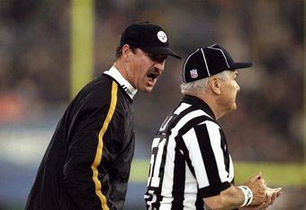 26 Nov 1998: Head coach Bill Cowher of the Pittsburgh Steelers talks to an official during the game against the Detroit Lions at the Pontiac Silverdome in Pontiac, Michigan. The Lions defeated the Steelers 19-16.