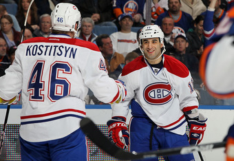 UNIONDALE, NY - FEBRUARY 09:  Scott Gomez #11 of the Montreal Canadiens celebrates his third period goal against the New York Islanders with teammate Andrei Kostitsyn #46 on February 9, 2012 at Nassau Coliseum in Uniondale, New York.  (Photo by Jim McIsaa