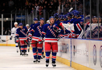 NEW YORK, NY - DECEMBER 08:  Ryan Callahan #24 of the New York Rangers is congratulated by his teammates for his goal in the first period against the Tampa Bay Lightning at Madison Square Garden on December 8, 2011 in New York City.  (Photo by Chris Trotm