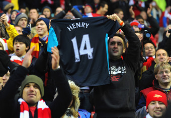 SUNDERLAND, ENGLAND - FEBRUARY 11: An Arsenal fan holds up a Thierry Henry shirt after he scored the winning goal during the Barclays Premier League match between Sunderland and Arsenal at the Stadium of Light on February 11, 2012 in Sunderland, England.