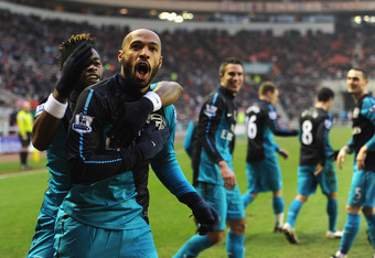 SUNDERLAND, ENGLAND - FEBRUARY 11:  Thierry Henry of Arsenal celebrates scoring to make it 2-1 with Alex Song (L) during the Barclays Premier League match between Sunderland and Arsenal at the Stadium of Light on February 11, 2012 in Sunderland, England.