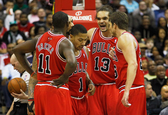 WASHINGTON, DC - JANUARY 30: Joakim Noah #13 of the Chicago Bulls talks with teammates Ronnie Brewer #11, Derrick Rose #1 and Kyle Korver #26 during the second half against the Washington Wizards at Verizon Center on January 30, 2012 in Washington, DC. NO