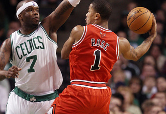 BOSTON, MA - JANUARY 13:  Jermaine O'Neal #7 of the Boston Celtics tries to block a shot by Derrick Rose #1 of the Chicago Bulls on January 13, 2012 at TD Garden in Boston, Massachusetts. NOTE TO USER: User expressly acknowledges and agrees that, by downl