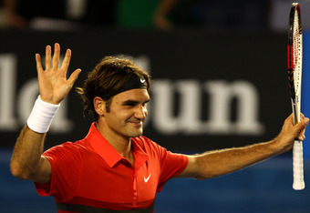 MELBOURNE, AUSTRALIA - JANUARY 22:  Roger Federer of Switzerland thanks the crowd after winning his fourth round match against  Bernard Tomic of Australia during day seven of the 2012 Australian Open at Melbourne Park on January 22, 2012 in Melbourne, Aus
