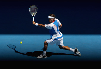 MELBOURNE, AUSTRALIA - JANUARY 22:  Feliciano Lopez of Spain plays a backhand in his fourth round match against Rafael Nadal of Spain during day seven of the 2012 Australian Open at Melbourne Park on January 22, 2012 in Melbourne, Australia.  (Photo by Qu