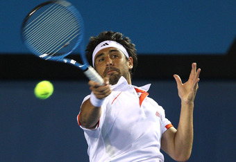 MELBOURNE, AUSTRALIA - JANUARY 18:  Marcos Baghdatis of Cyprus plays a forehand in his second round match against Stanislas Wawrinka of Switzerland  during day three of the 2012 Australian Open at Melbourne Park on January 18, 2012 in Melbourne, Australia
