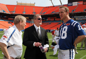 MIAMI GARDENS, FL - FEBRUARY 02:  (L-R) General manager Bill Polian, team owner Jim Irsay and Peyton Manning #18 of the Indianapolis Colts look on during Super Bowl XLIV Media Day at Sun Life Stadium on February 2, 2010 in Miami Gardens, Florida.  (Photo