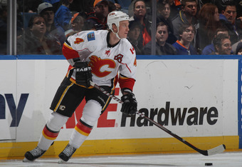 UNIONDALE, NY - DECEMBER 29: Jay Bouwmeester #4 of the Calgary Flames skates against the New York Islanders at the Nassau Veterans Memorial Coliseum on December 29, 2011 in Uniondale, New York. The Islanders defeated the Flames 3-1.  (Photo by Bruce Benne