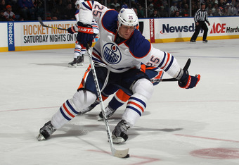 UNIONDALE, NY - DECEMBER 31:  Andy Sutton #25 of the Edmonton Oilers skates against the New York Islanders at the Nassau Veterans Memorial Coliseum on December 31, 2011 in Uniondale, New York. The Islanders defeated the Oilers 4-1.  (Photo by Bruce Bennet