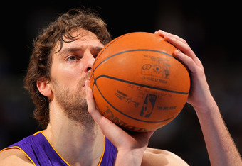 DENVER, CO - FEBRUARY 03:  Pau Gasol #16 of the Los Angeles Lakers takes a free throw against the Denver Nuggets at the Pepsi Center on February 3, 2012 in Denver, Colorado. NOTE TO USER: User expressly acknowledges and agrees that, by downloading and or