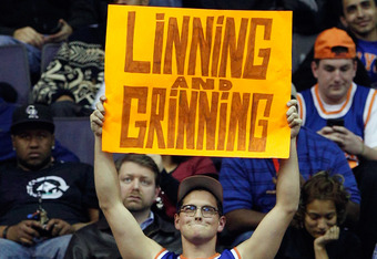 WASHINGTON, DC - FEBRUARY 08: A fan of Jeremy Lin #17 of the New York Knicks holds up a sign during the second half of the Knicks and Washington Wizards game at Verizon Center on February 8, 2012 in Washington, DC.  NOTE TO USER: User expressly acknowledg