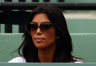 KEY BISCAYNE, FL - MARCH 29:  Kim Kardashian watches as Roger Federer of Switzerland plays against Florent Serra of France on day seven of the 2010 Sony Ericsson Open at Crandon Park Tennis Center on March 29, 2010 in Key Biscayne, Florida.  (Photo by Mic