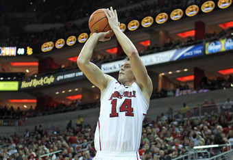 LOUISVILLE, KY - NOVEMBER 28: Kyle Kuric #14 of the Louisville Cardinals shoots the ball during the game against the Long Beach State 49ers at KFC YUM! Center on November 28, 2011 in Louisville, Kentucky.  (Photo by Andy Lyons/Getty Images)