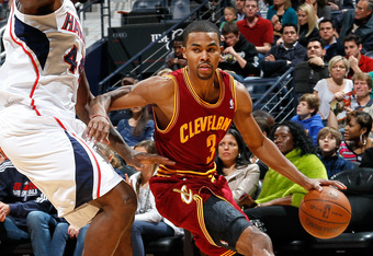 ATLANTA, GA - JANUARY 21:  Ramon Sessions #3 of the Cleveland Cavaliers against Ivan Johnson #44 of the Atlanta Hawks at Philips Arena on January 21, 2012 in Atlanta, Georgia.  NOTE TO USER: User expressly acknowledges and agrees that, by downloading and