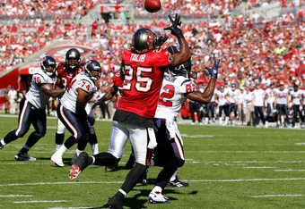 TAMPA, FL - NOVEMBER 13:  Defensive back Aqib Talib #25 of the Tampa Bay Buccaneers looks to intercept a pass against the Houston Texans during the game at Raymond James Stadium on November 13, 2011 in Tampa, Florida.  (Photo by J. Meric/Getty Images)