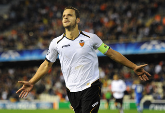 VALENCIA, SPAIN - NOVEMBER 23:  Roberto Soldado of Valencia celebrates scoring his sides third goal during the UEFA Champions League group E match between Valencia CF and KRC Genk at Estadio Mestalla on November 23, 2011 in Valencia, Spain.  (Photo by Jas