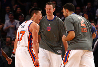 NEW YORK, NY - FEBRUARY 10:  (L-R) Jeremy Lin #17, Steve Novak #16 and Landry Fields #2 of the New York Knicks celebrate after Lin made a 3-point basket in the fourth quarter at Madison Square Garden on February 10, 2012 in New York City.  NOTE TO USER: U