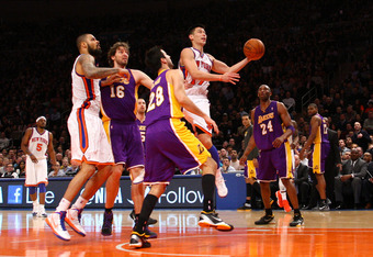 NEW YORK, NY - FEBRUARY 10:  Jeremy Lin #17 of the New York Knicks drives for a shot attempt in the fourth quarter against Jason Kapono #28 and Kobe Bryant #24 of the Los Angeles Lakers at Madison Square Garden on February 10, 2012 in New York City.  NOTE