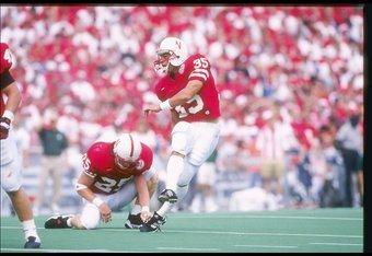 7 Sep 1996:  Offensive back Jon Vedral of the Nebraska Cornhuskers holds the ball as place kicker Kris Brown kicks it away during a game against the Michigan State Spartans at Memorial Stadium in Lincoln, Nebraska.  Nebraska won the game 55-14. Mandatory