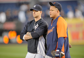 NEW YORK, NY - OCTOBER 06:  (L-R) A.J. Burnett #34 of the New York Yankees and Miguel Cabrera #24 of the Detroit Tigers talk during batting practice prior to Game Five of the American League Championship Series at Yankee Stadium on October 6, 2011 in the