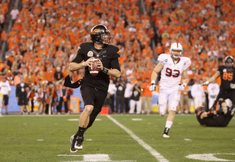GLENDALE, AZ - JANUARY 02:  Brandon Weeden #3 of the Oklahoma State Cowboys looks to pass as he rolls out of the pocket against the Stanford Cardinal during the Tostitos Fiesta Bowl on January 2, 2012 at University of Phoenix Stadium in Glendale, Arizona.