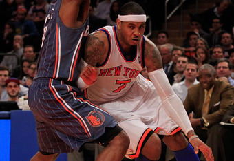 NEW YORK, NY - JANUARY 09: (R) Carmelo Anthony #7 of the New York Knicks drives against (R) D.J. White #8 of the Charlotte Bobcats at Madison Square Garden on January 9, 2012 in New York City. NOTE TO USER: User expressly acknowledges and agrees that, by